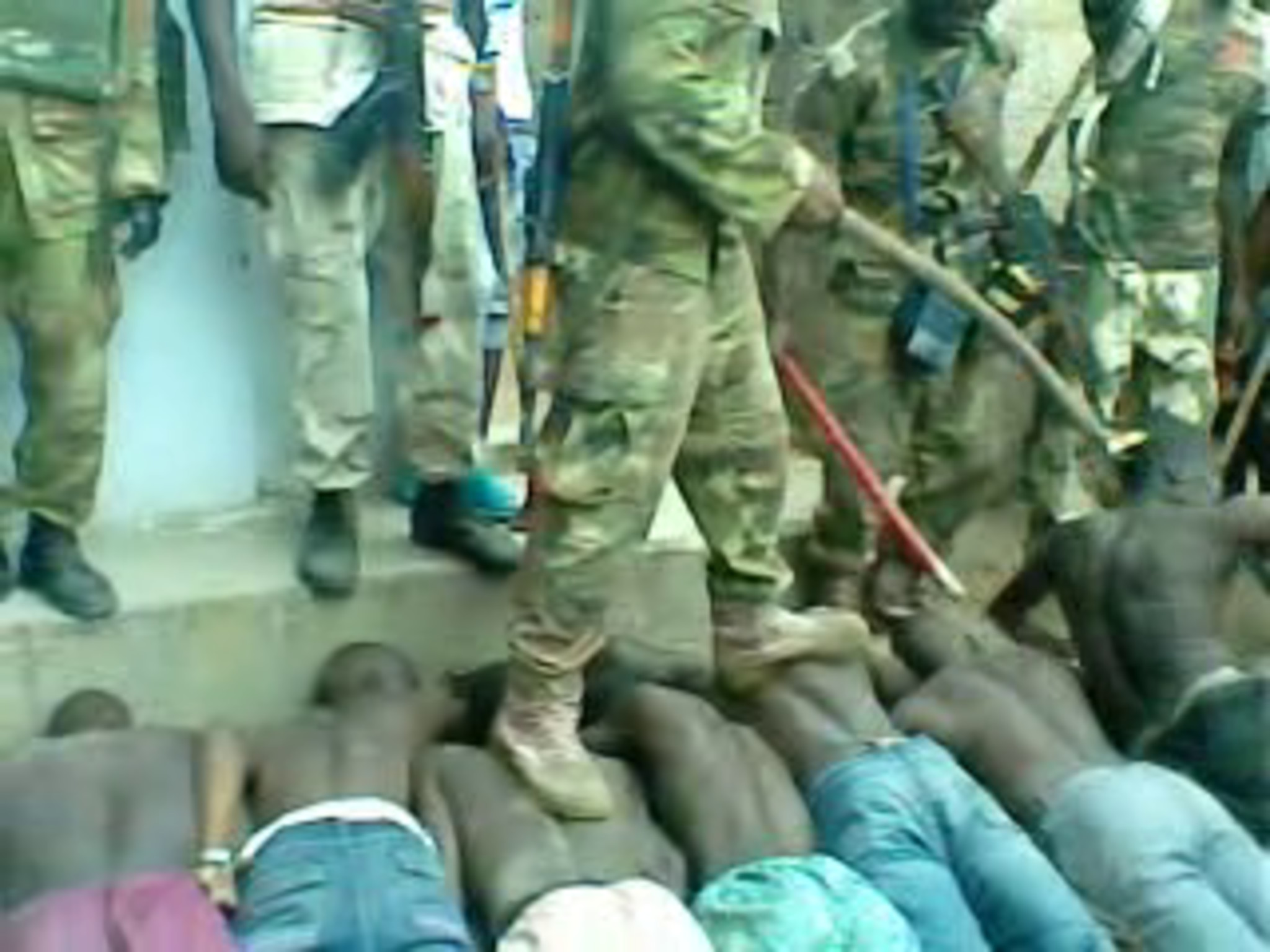 Images taken from a video of a 'screening' operation by the Nigerian military and Civilian Joint Task Force on 23 July 2013 in Bama town, Nigeria. More than 300 men were passed in front of a hidden informant. Up to 35 men were arrested on suspicion of being Boko Haram members. On 29 July 2013 military personnel took the men out of the barracks in Bama and brought them to their communities, where the soldiers shot them dead. The video was taken by a member of the Civilian Joint Task Force.