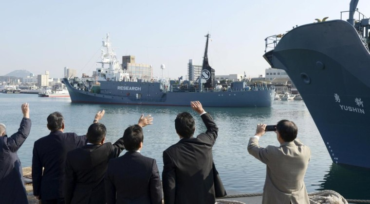 Officials wave as Japanese whaling vessel Yushin Maru No.2 leaves for the Antartic Ocean at a port in Shimonoseki, southwestern Japan, in this photo taken by Kyodo December 1, 2015. Mandatory credit REUTERS/Kyodo ATTENTION EDITORS - THIS PICTURE WAS PROVIDED BY A THIRD PARTY. REUTERS IS UNABLE TO INDEPENDENTLY VERIFY THE AUTHENTICITY, CONTENT, LOCATION OR DATE OF THIS IMAGE. THIS PICTURE IS DISTRIBUTED EXACTLY AS RECEIVED BY REUTERS, AS A SERVICE TO CLIENTS. FOR EDITORIAL USE ONLY. NOT FOR SALE FOR MARKETING OR ADVERTISING CAMPAIGNS. MANDATORY CREDIT. JAPAN OUT. NO COMMERCIAL OR EDITORIAL SALES IN JAPAN.