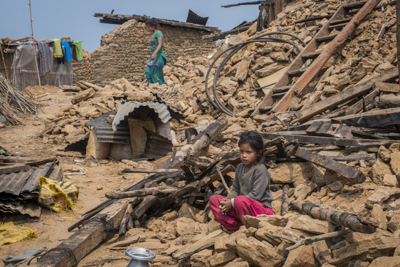A girl sits on the rubble of her collapsed house in Tasarphu, a village close to the quake's epicenter. A deadly earthquake hit Nepal near Kathmandu, April 25, 2015.